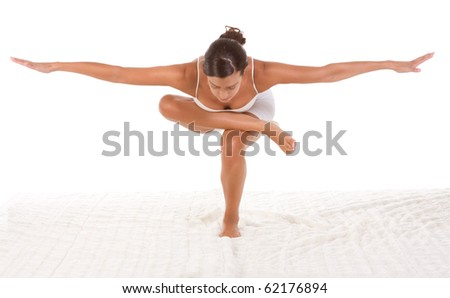 """yoga pose """"Standing/Squatting pigeon"""" - female in sport clothes performing exercise - stock photo"""