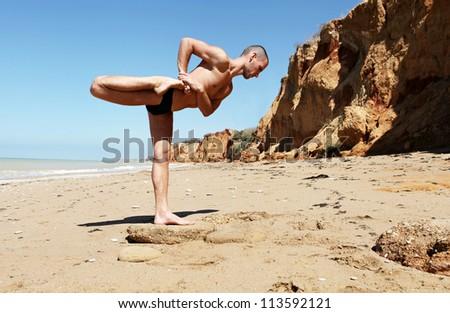Yoga practice.Man doing variation of Warrior from Virabhadra Yoga pose - stock photo