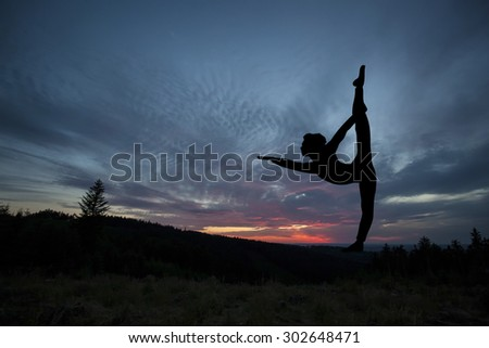 Yoga practicioner during the sunset meditation