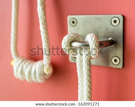 Yoga rope equipment on a wall at yoga studio - stock photo