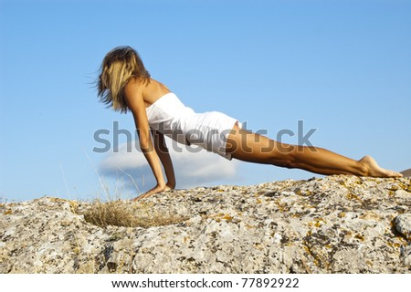 Yoga seria: Urdhva Mukha Svanasana, a position in Yoga, is also called Upward Facing Dog - stock photo