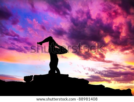 Yoga shirshasana head standing inverted pose by man silhouette with purple dramatic sunset sky background. Free space for text and can be used as template for web-site - stock photo