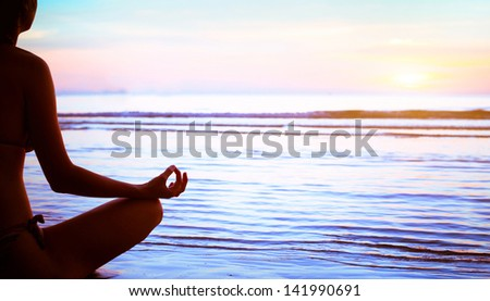 yoga, silhouette of meditating woman - stock photo