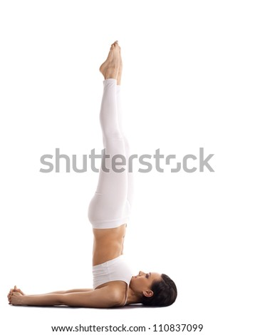 yoga trainer in white stand on spine isolated