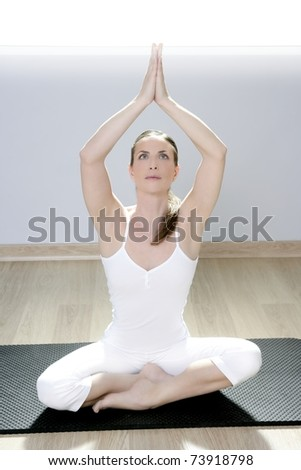 yoga woman fitness girl in white meditation at gym on mat - stock photo