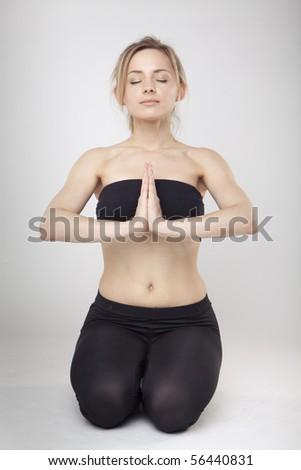 Yoga Woman in studio - stock photo