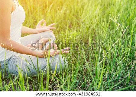 Yoga woman In the lotus posture. - stock photo