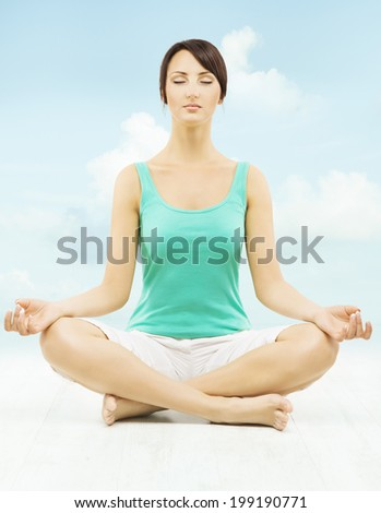 Yoga woman meditate sitting in lotus pose over sky background.   - stock photo