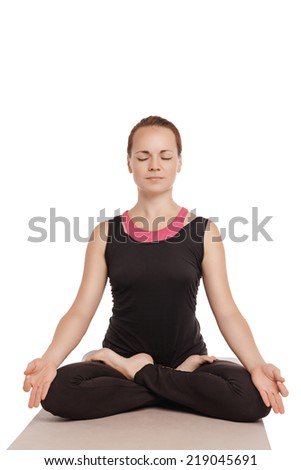 Yoga woman meditating and making a zen symbol with her hand isolated over white - stock photo
