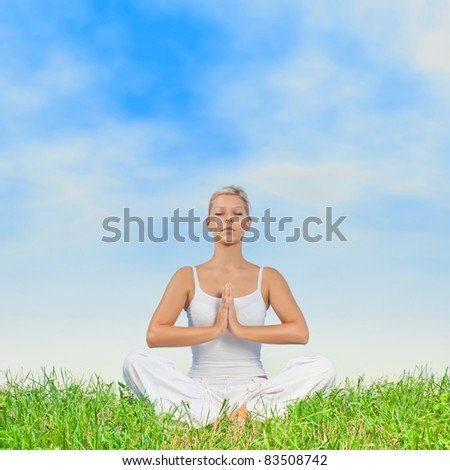 Yoga woman meditating outdoors with copyspace. - stock photo