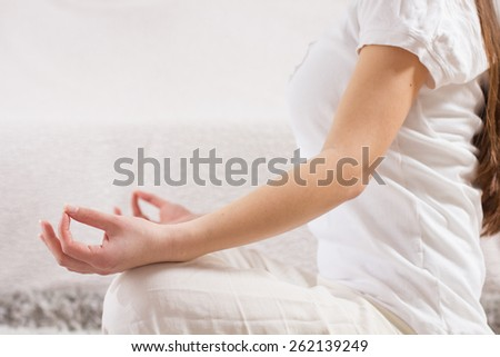 Yoga Woman Meditating Relaxing at home.Healthy Lifestyle in Lotus Posture .Unrecognizable caucasian female practicing on the floor.
