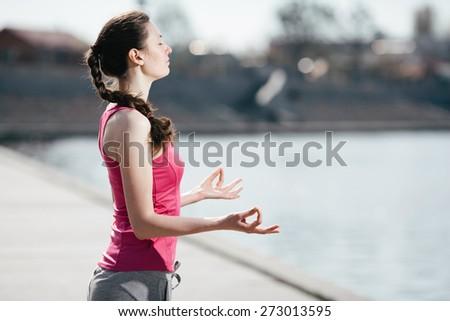 yoga woman near the beach in yoga pose - stock photo