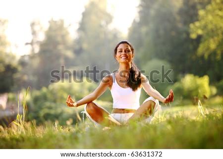 yoga woman on green gras - stock photo