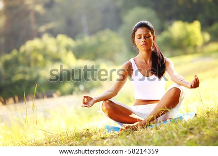 yoga woman on green grass - stock photo