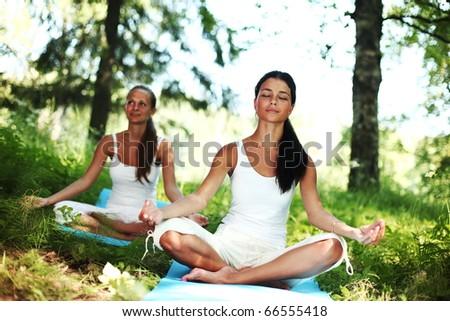 yoga woman on green grass - stock photo