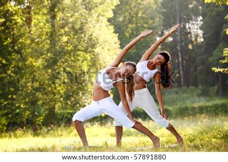 yoga woman on green park - stock photo