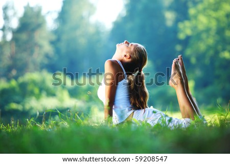 yoga woman on green park - stock photo