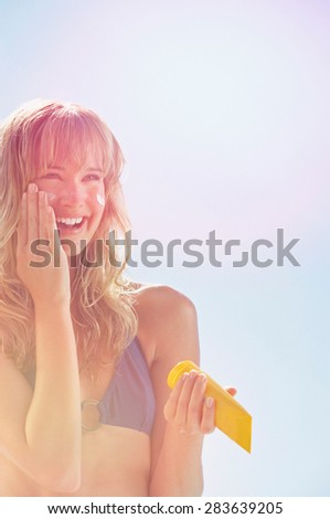 Yoga woman performs an exercise on the beach - stock photo