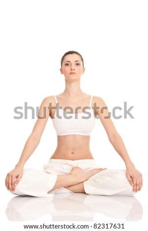 yoga, young woman doing yoga exercise, isolated on background - stock photo