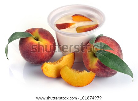 yoghurt with peach and pieces on a white background