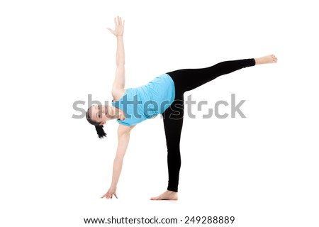 Yogi girl on white background exercises in yoga posture ardha chandrasana (Half Moon Pose) - stock photo