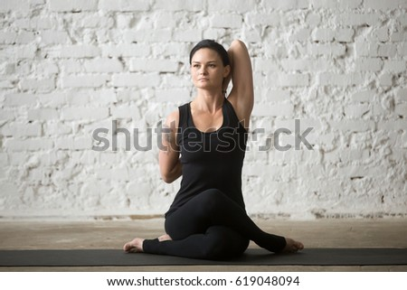 yogi mid aged attractive woman practicing stock photo