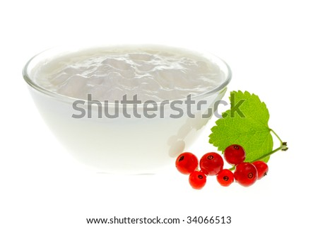 Yogurt bowl with Redcurrant berries on white background - stock photo