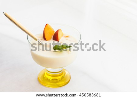 Yogurt dessert with peaches. Summer dessert - stock photo