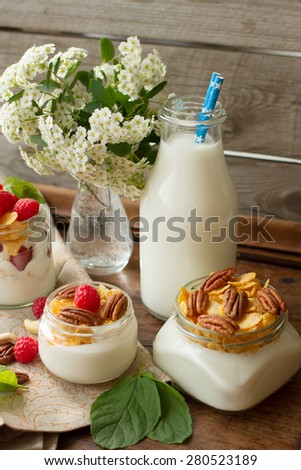 yogurt for breakfast with nuts, raspberry and milk. Diet for Women - stock photo