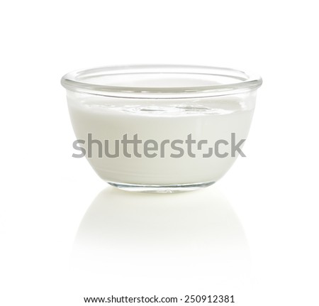 Yogurt in a glass bowl isolated on white with reflection