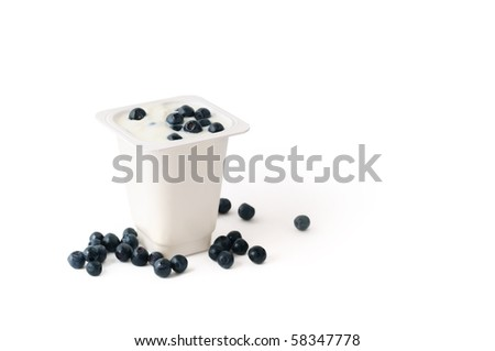Yogurt in white plastic box with blueberries isolated - stock photo