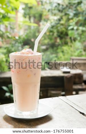yogurt smoothie at garden background - stock photo