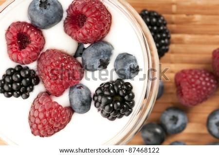 Yogurt with blueberries, raspberries and blackberries - stock photo