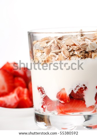 yogurt with cereal and strawberries - stock photo