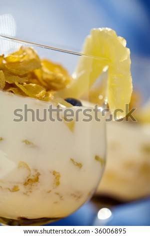 Yogurt with Corn Flakes and Pineapple - stock photo