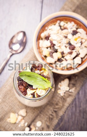 yogurt with nuts,basil,muesli and dry berry in container in studio