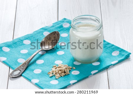 yogurt with  oat flakes on wooden table