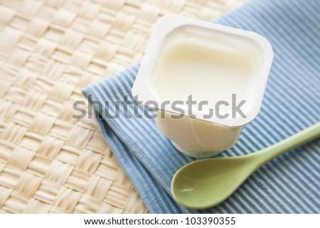 Yogurt with spoon - stock photo