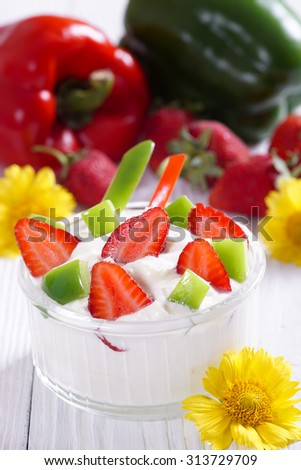 Yogurt with strawberries and sweet pepper. Light breakfast.