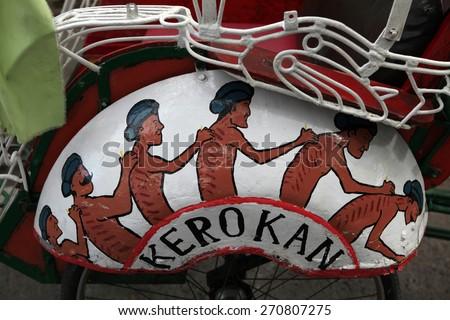 YOGYAKARTA, INDONESIA - AUGUST 4, 2011: Advertising of traditional Indonesian folk cure Kerokan on a rickshaw cart in Yogyakarta, Central Java, Indonesia - stock photo