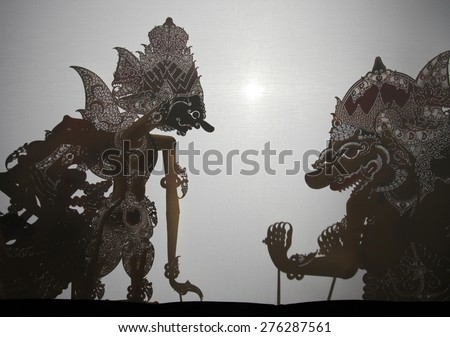 YOGYAKARTA, INDONESIA - AUGUST 13, 2012: Traditional Indonesian shadow puppet theatre wayang kulit performs on street during a religious festival in Yogyakarta, Central Java, Indonesia. - stock photo