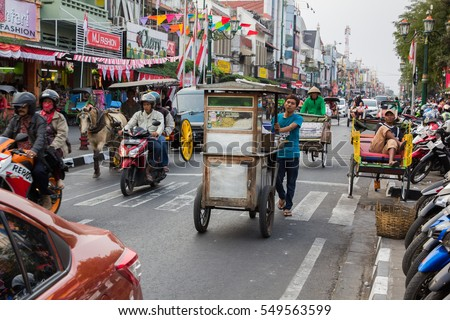 YOGYAKARTA, INDONESIA - AUGUST 14: View of Yogyakarta with its typical hundreds of motorbikes on August 14, 2015. in Yogyakarta, Indonesia. Motorbikes are all around this city.