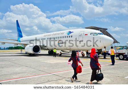 Yogyakarta - OCT 11: Garuda Indonesia Airbus A330-243 lands at Yogyakarta Airport in Indonesia on October 11, 2013. Garuda Indonesia is the flag carrier of Indonesia. - stock photo