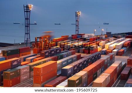 YOKOHAMA -AUGUST 08 : Containers at Yokohama commercial port on august 08, 2013 in Yokohama, Japan  - stock photo