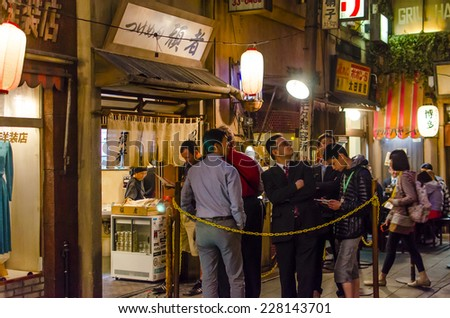 YOKOHAMA,JAPAN - 20 April,2014 : A queue of people waiting for a meal. Shin-Yokohama Ramen Museum was founded on March 6th, 1994 as the world's first food-themed amusement park. - stock photo