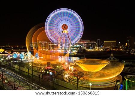 YOKOHAMA, JAPAN - JAN 15: Long-exposure image of amusement park rides at Yokohama Cosmo World. Jan 15, 2012 in Yokohama, Japan. - stock photo