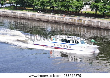 Yokohama, Japan - May 26, 2015 : Japanese people is sitting in small boat in Yokohama, Japan - stock photo