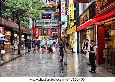 YOKOHAMA, JAPAN - MAY 10, 2012: Visitors walk Chinatown in Yokohama, Japan. Yokohama's Chinatown is the largest in Japan and a popular tourism attraction.