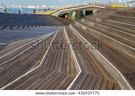 YOKOHAMA, JAPAN - NOVEMBER 24 2015: Osanbashi Pier is the main international passenger pier in Yokohama. The pier is also known as one of the best places to see the Yokohama Three Towers - stock photo