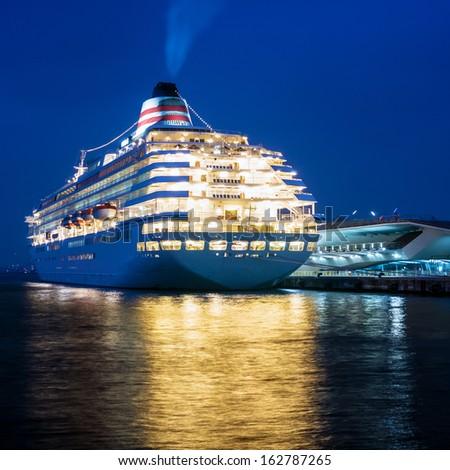 YOKOHAMA, JAPAN - NOVEMBER 26: The Asuka II was moored at a pier in Yokohama harbor on November 26, 2010 in Yokohama, Japan. It was the largest cruise ship in Japan. - stock photo